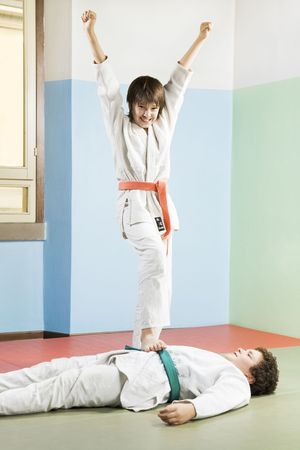 combative sport: young boys in kimono playing martial arts  LANG_EVOIMAGES