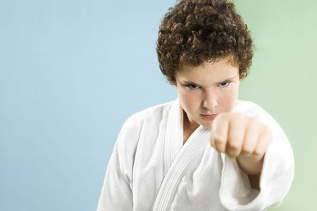 young boy in kimono playing martial arts Stock Photo - 3660753