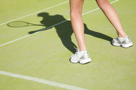 individual sport: woman playing tennis, about to hit the ball. Copy space