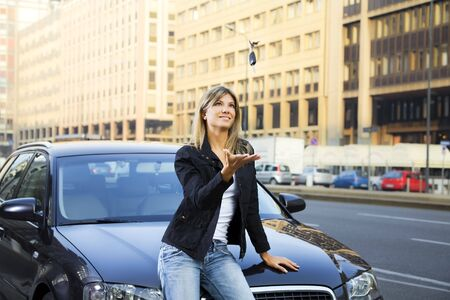 Young woman playing with keys of new car Stock Photo - 3755565