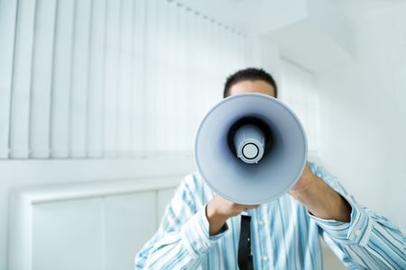 young businessman in office screaming on the megaphone Stock Photo - 3765575