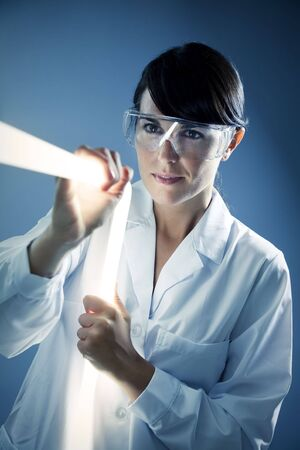 Italian woman holding neon stick in lab photo