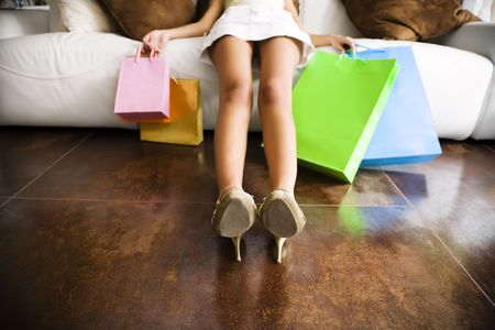 Woman relaxing on couch after long day shopping  photo
