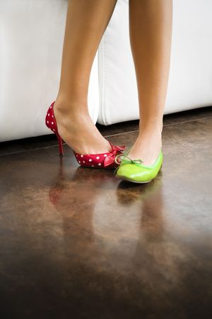 mistake: Cropped view of woman wearing mismatched shoes