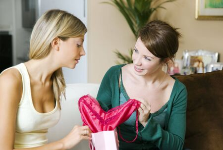 seduction: Friends looking at fuchsia underwear together