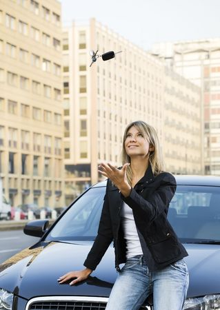 Young woman playing with keys of new car  Stock Photo