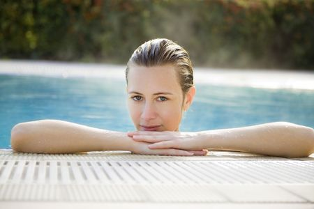 Portrait of young woman in spa, front view  photo