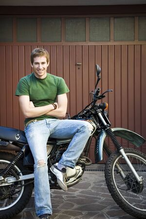 Portrait of young man sitting on motorbike Stock Photo - 3868439
