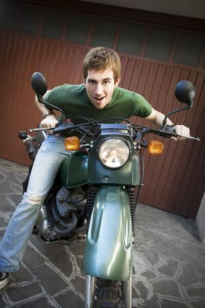 Portrait of young man sitting on motorbike Stock Photo - 3881417