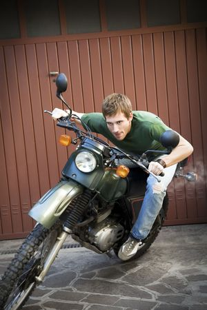 Portrait of young man driving vintage motorbike Stock Photo - 3903072