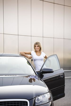 Young woman holding keys to new car Stock Photo - 3911102