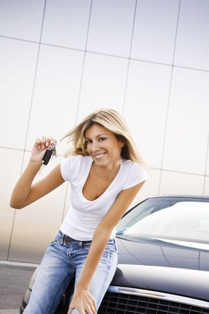 Young woman holding keys to new car Stock Photo - 3911101