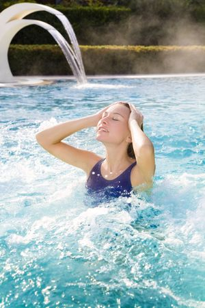 young blond woman relaxing in beauty spa Stock Photo