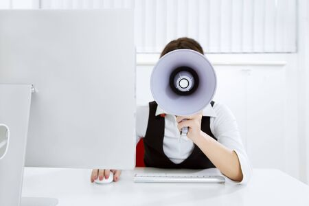 young businesswoman in office talking on the megaphone Stock Photo - 3941522