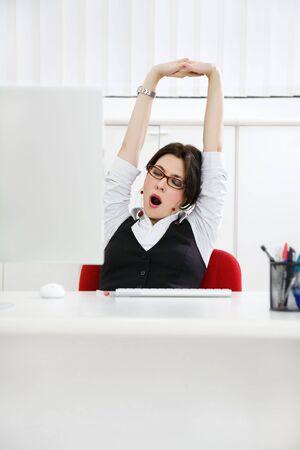 Young businesswoman sitting at desk yawning. Copy space Stock Photo - 3951268