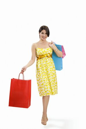 Mid adult Italian woman holding red shopping bags on white background photo