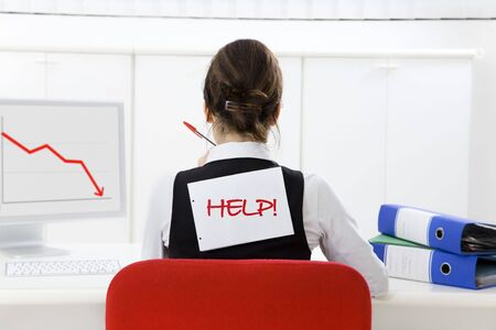 Rear view of businesswoman in office worried about loss of profits Stock Photo - 3988958