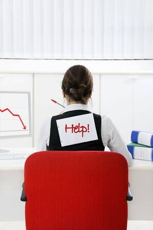 Rear view of businesswoman in office worried about loss of profits Stock Photo - 3988960