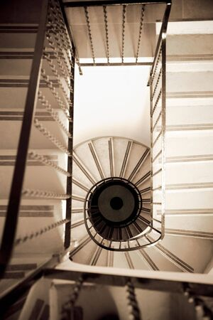 high angle view of old spiral staircase photo