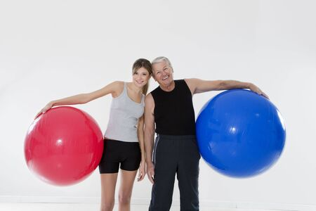 senior adult and daughter exercising with fitness ball in gym Stock Photo - 4145332