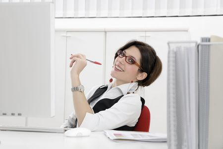 trustful: Portrait of young woman sitting at desk in office Stock Photo