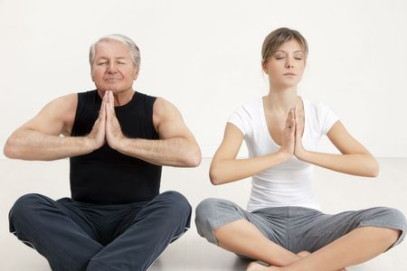 senior man and young woman doing yoga Stock Photo - 4164426
