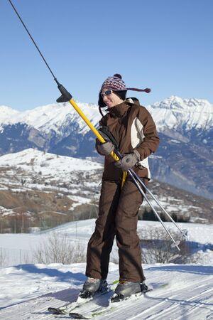 female skier moving up on ski lift photo