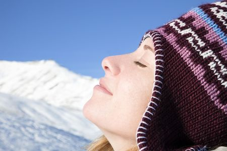 breathe: side view of young woman enjoying mountain Stock Photo