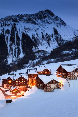 Illuminated french mountain village in the evening photo