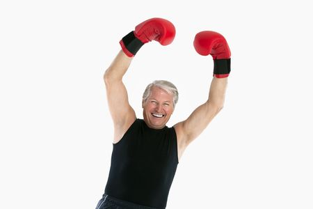 happy senior man with red boxing gloves photo
