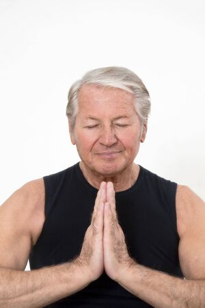 senior man doing yoga indoors. Copy space Stock Photo - 4279520