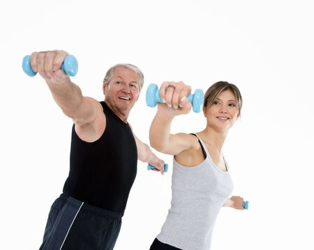 senior man and young woman exercising in gym. White background photo