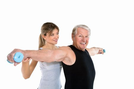 senior man and young woman exercising in gym. Copy space Stock Photo - 4313609