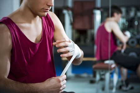 cropped view of boxer wrapping his hands in gym. Copy space Stock Photo - 4337156