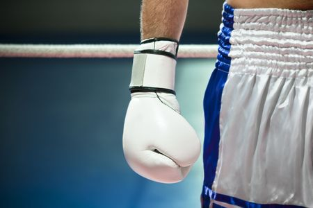 boxing sport: cropped view of man with boxing gloves. Copy space