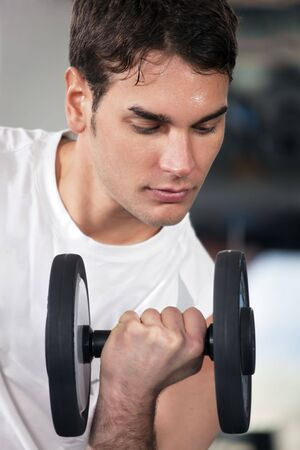portrait of young man doing weightlifting in gym Stock Photo - 4357315