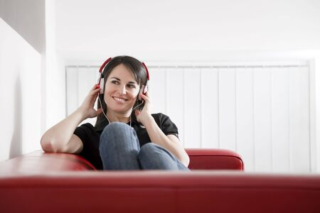 mid adult woman listening to music at home. Copy space  photo