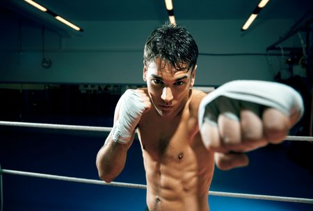 bare waist: young adult man boxing in gym. Copy space