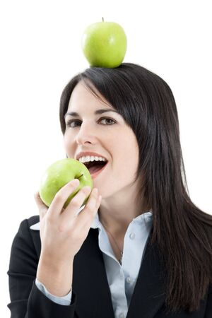 mid adult woman with green apple on head on white background photo