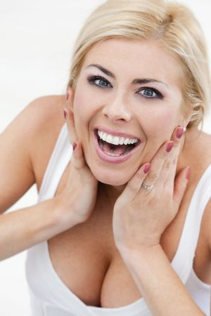 angle view: high angle view of amazed blond woman looking at camera
