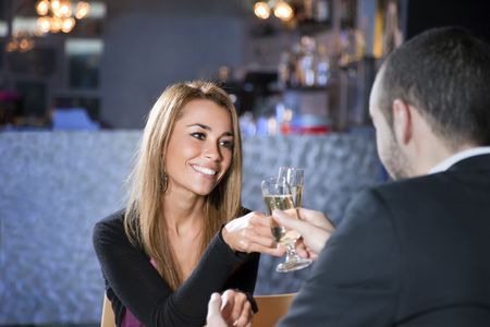 mid adult couple toasting in restaurant. Copy space Stock Photo