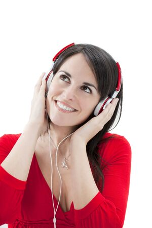 mid adult woman listening to music on white background. photo