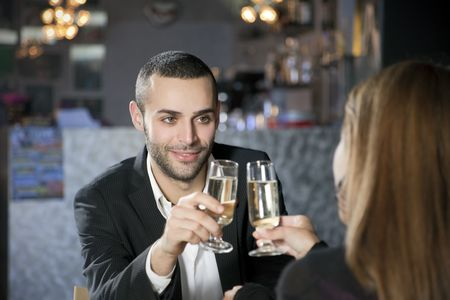 mid adult couple toasting in restaurant. Copy space photo