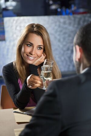 adult dating: mid adult couple toasting in restaurant. Copy space Stock Photo