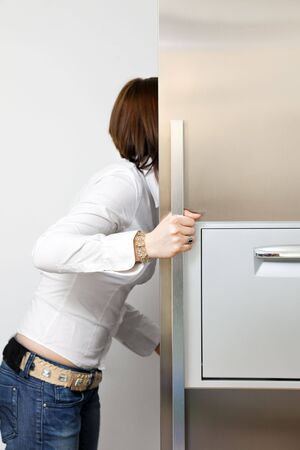 hungry woman looking into fridge. Copy space Stock Photo - 4563077