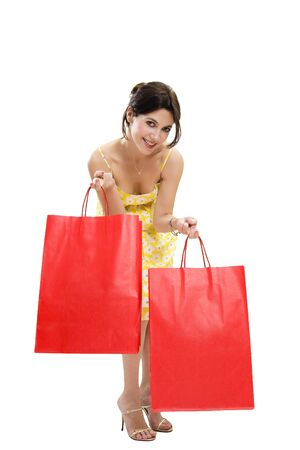 Mid adult woman holding red shopping bags on white background photo