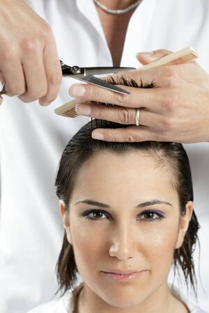portrait of young woman having her hair being cut Stock Photo - 4601686