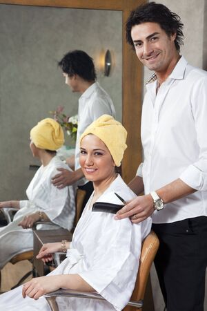 hairstylist and customer looking at camera and smiling Stock Photo - 4632697