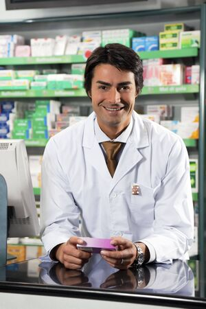 shop skill: portrait of mid adult pharmacist looking at camera