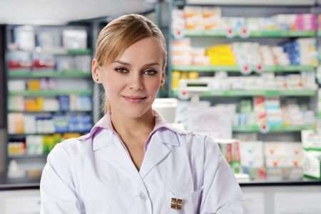 pharmacist: portrait of mid adult pharmacist looking at camera